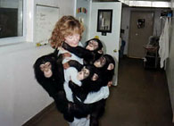 Nancy with four young chimpanzees
